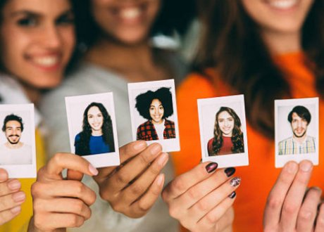 women holding pictures of people